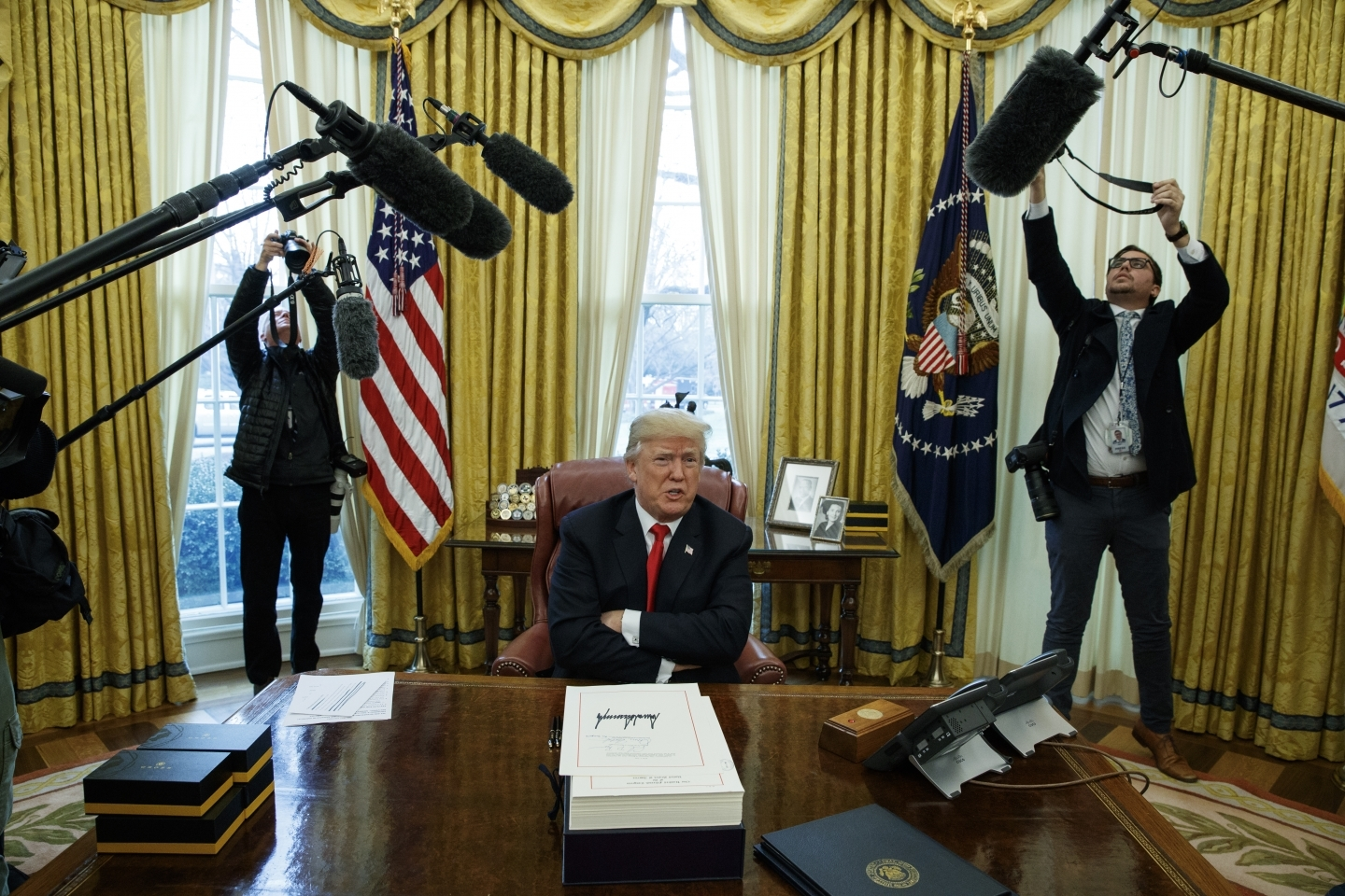 President Donald Trump signed the tax bill and the continuing resolution to fund the government on Friday, Dec. 22, 2017 in Washington. (AP Photo/Evan Vucci)