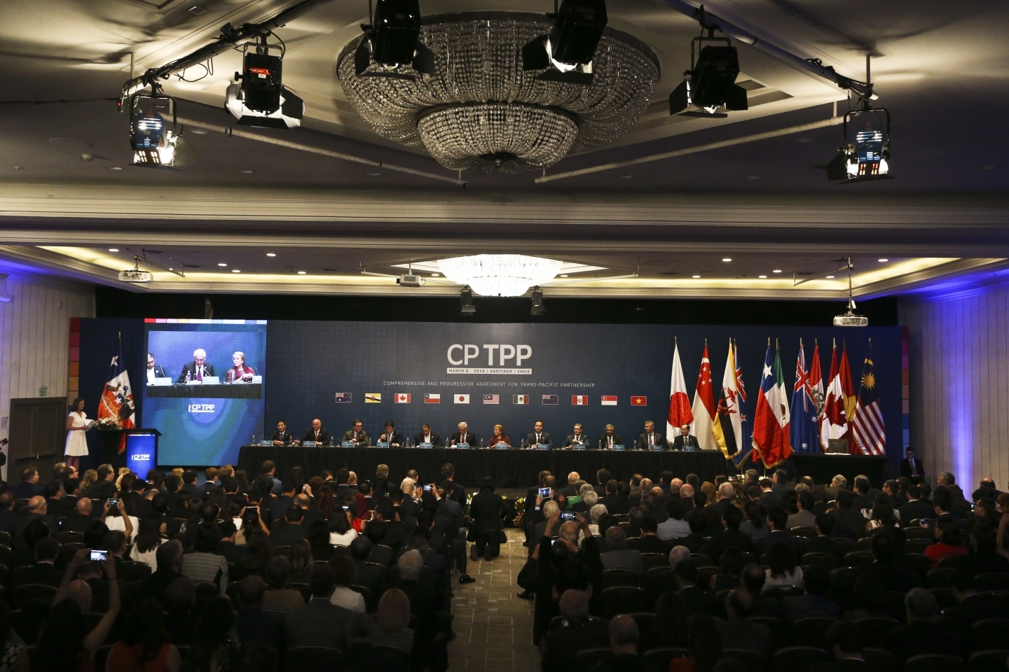 Representatives from 11 countries take part in the Comprehensive and Progressive Agreement for Trans-Pacific Partnership signing ceremony on March 8, 2018. (AP Photo/Esteban Felix)