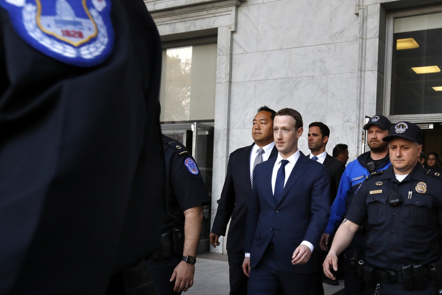 Facebook CEO Mark Zuckerberg leaves the Rayburn House Office Building after testifying on Capitol Hill in Washington on April 11, 2018. (AP Photo/Jacquelyn Martin)