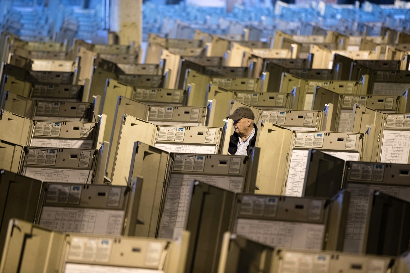 A technician works to prepare voting machines for voters in advance of the 2016 US presidential election. (AP Photo/Matt Rourke)