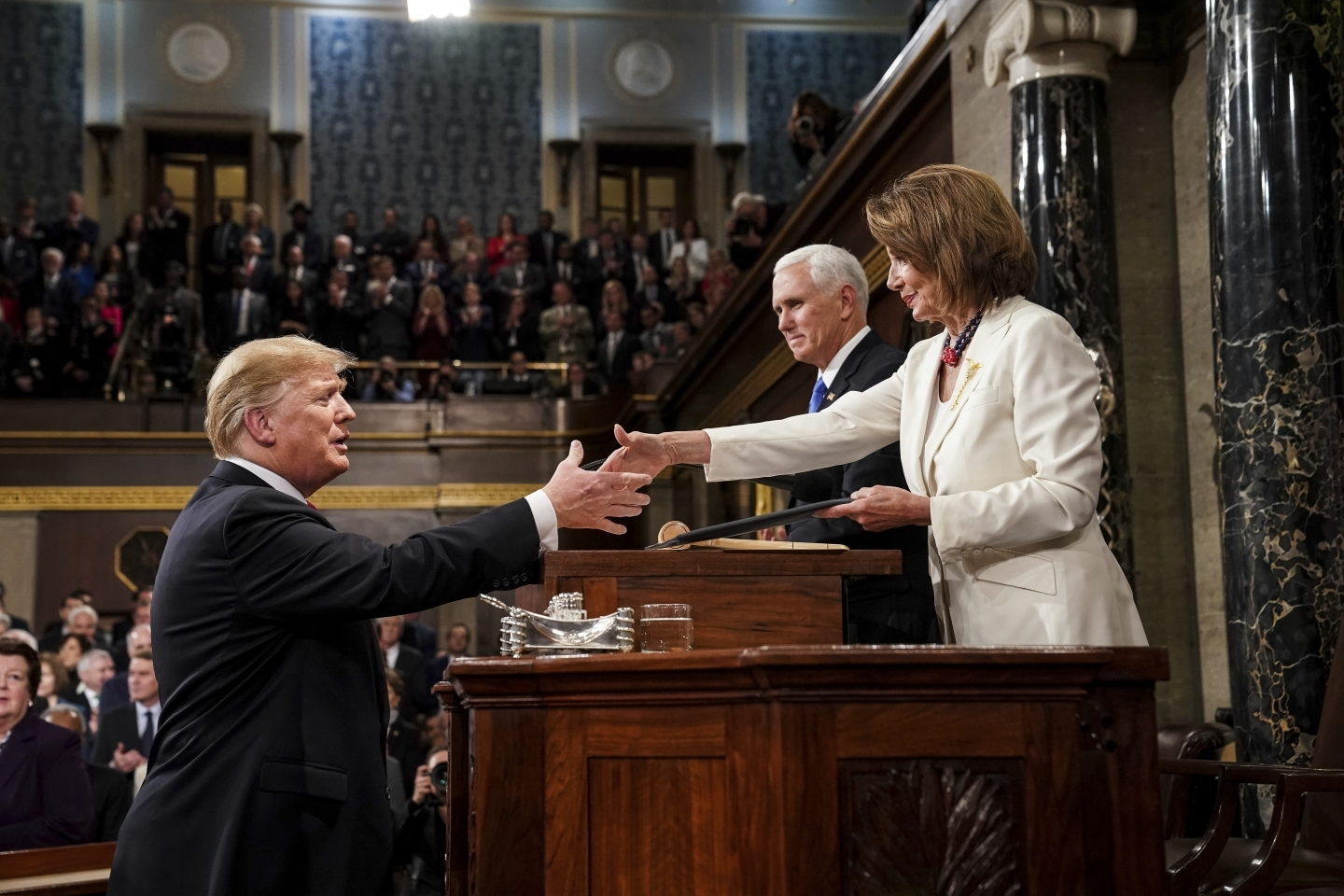 President Donald Trump shakes hands with House Speaker Nancy Pelosi as he arrives in the House chamber before giving his State of the Union address on February 5, 2019. (Doug Mills/The New York Times via AP, Pool)