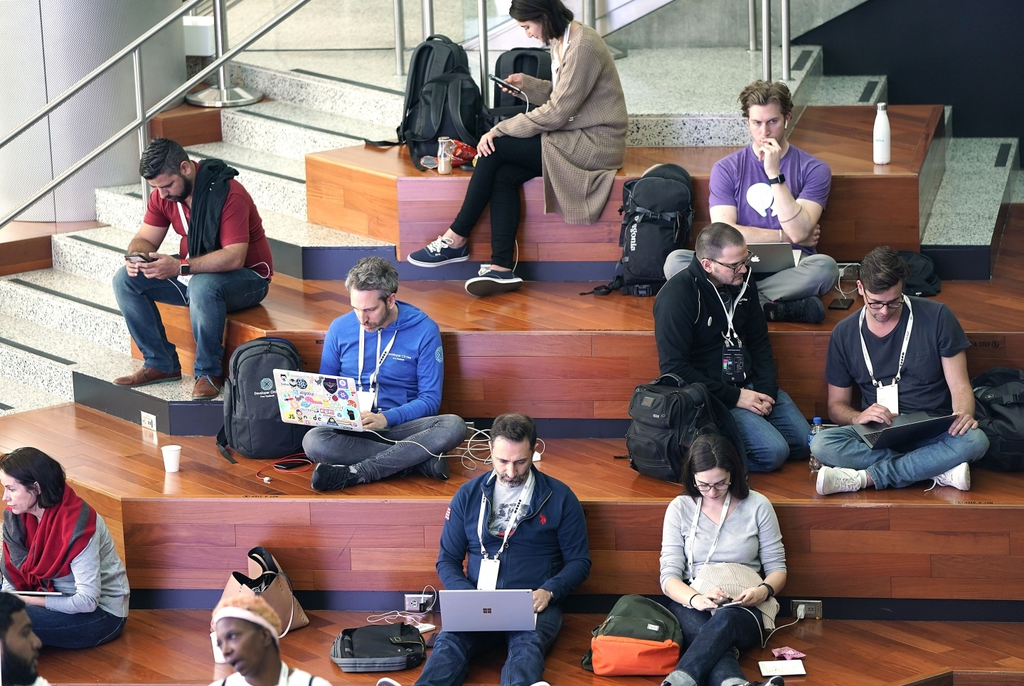 Attendees work on their computers at Facebook's developer conference on April 30, 2019, in San Jose. (AP Photo/Tony Avelar )