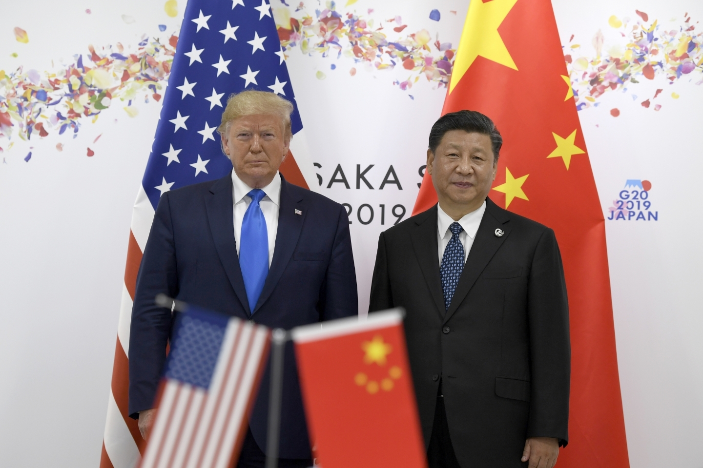 President Donald Trump, left, poses for a photo with Chinese President Xi Jinping during a meeting on the sidelines of the G20 summit in Osaka, Japan on June 29, 2019. (AP Photo/Susan Walsh)