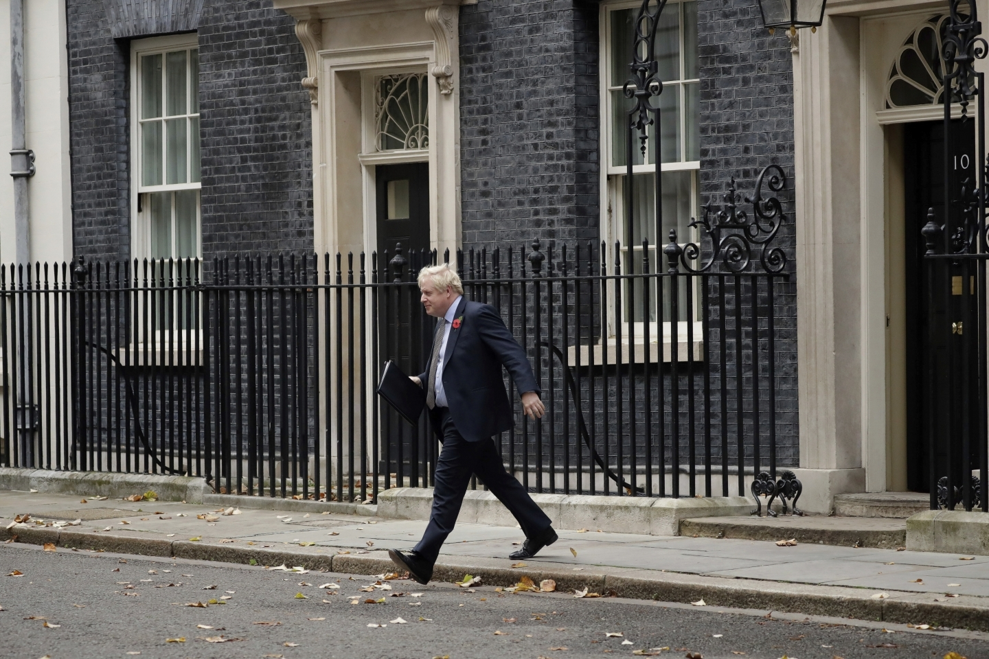 Britain's Prime Minister Boris Johnson walks from the front door of 10 Downing Street, London, on November 6, 2019 ahead of the formal start of the general election. (AP Photo/Matt Dunham)