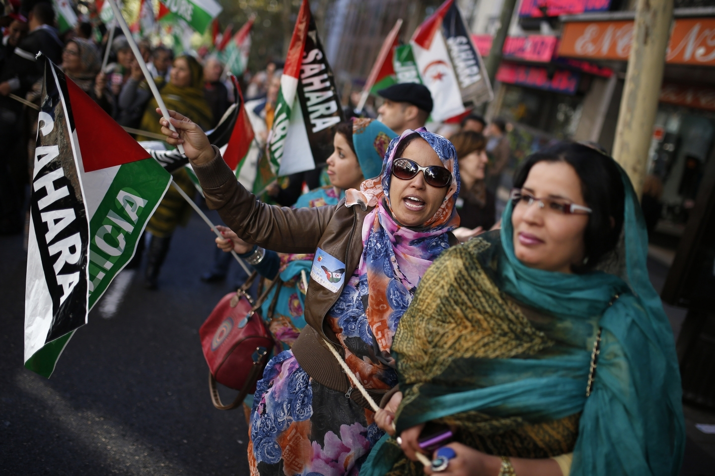 Women from Western Sahara shout slogans in support of Free Western Sahara, during a protest in Madrid (AP Photo/Andres Kudacki)