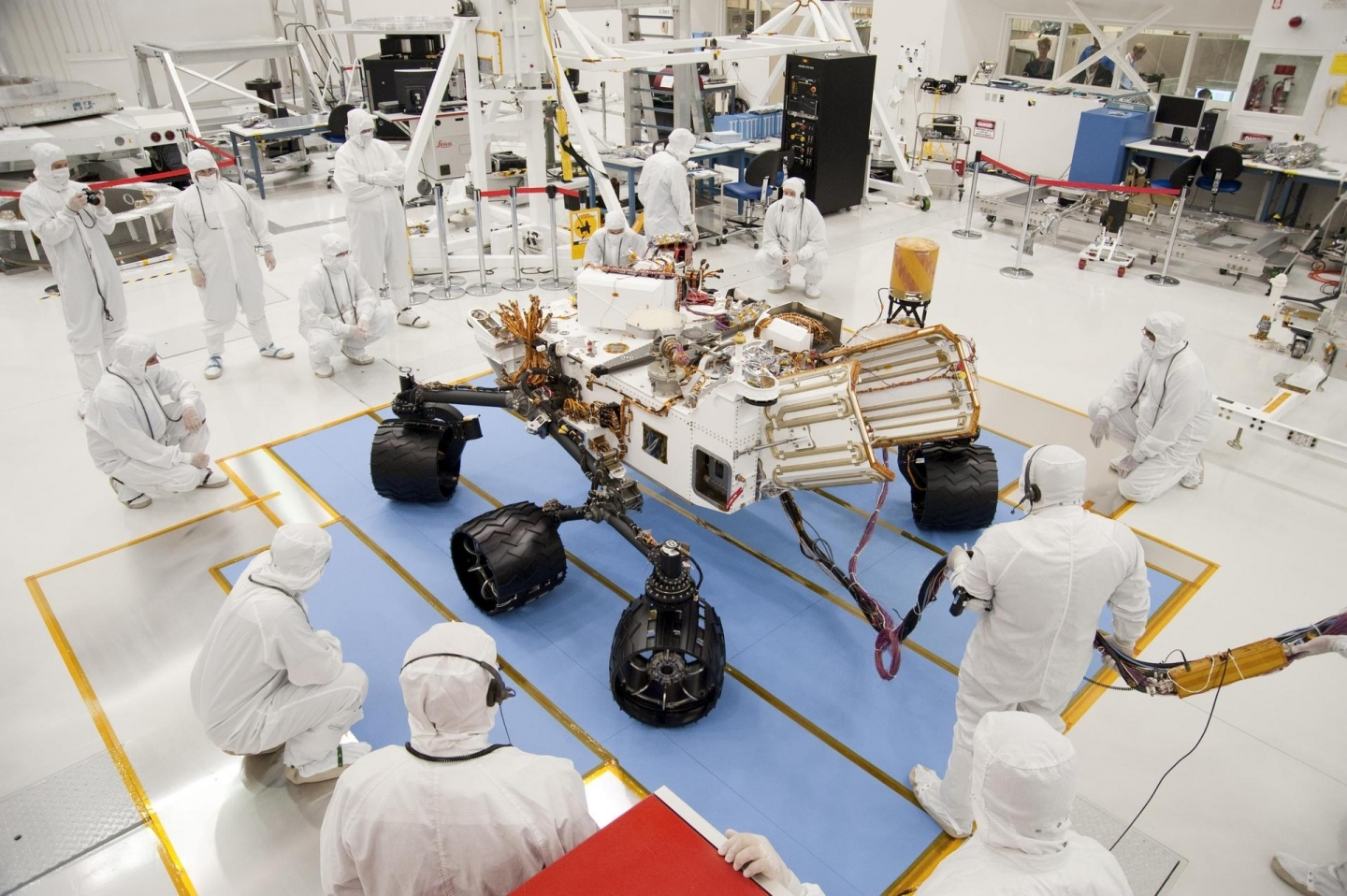 Technicians and engineers in clean-room garb monitor the first drive test of NASA Curiosity rover on July 23, 2010. (NASA/JPL-Caltech)