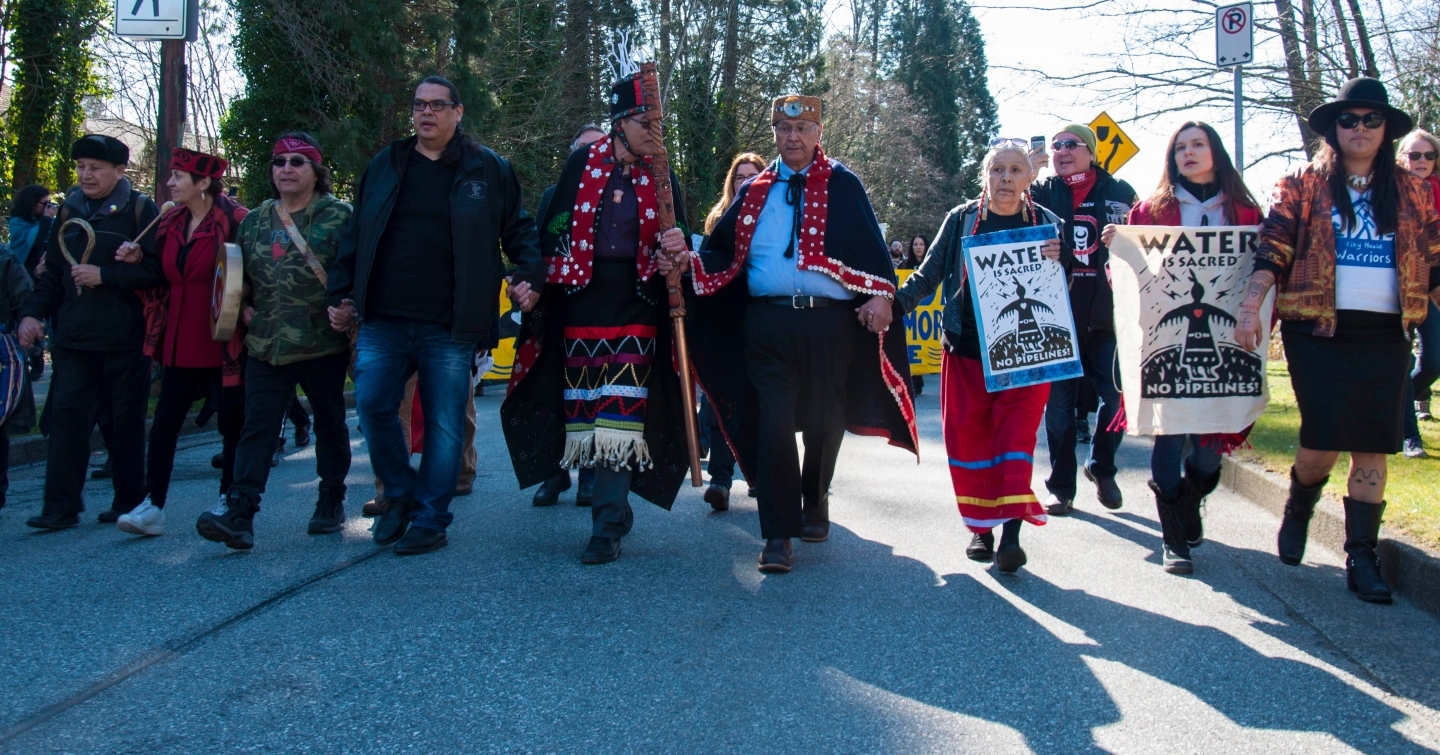 Demonstrators in Burnaby, British Columbia take part in the Protect the Inlet march against the Trans Mountain pipeline expansion. (Shutterstock)