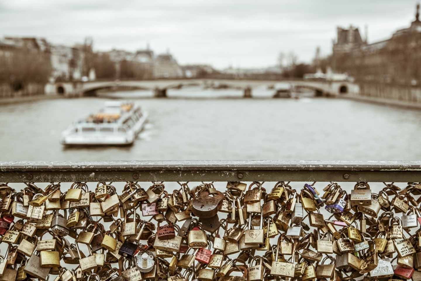Love locks attached to the railing of a bridge in Paris (Shutterstock)
