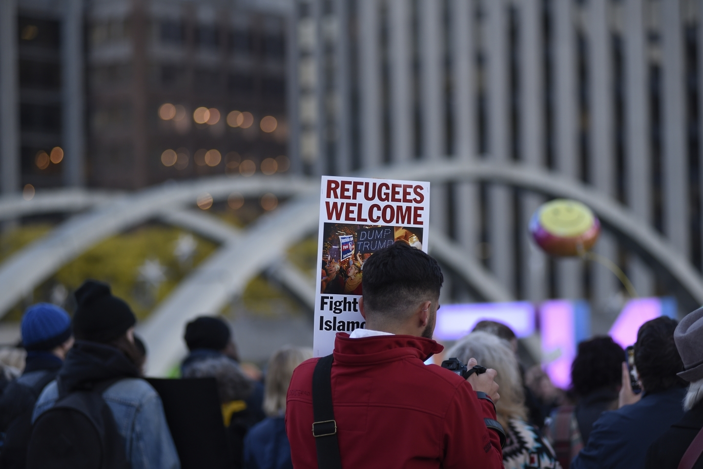 A demonstrator holds a sign welcoming refugees to North America during a protest rally on November 13, 2016 in Toronto, Canada. (Shutterstock)