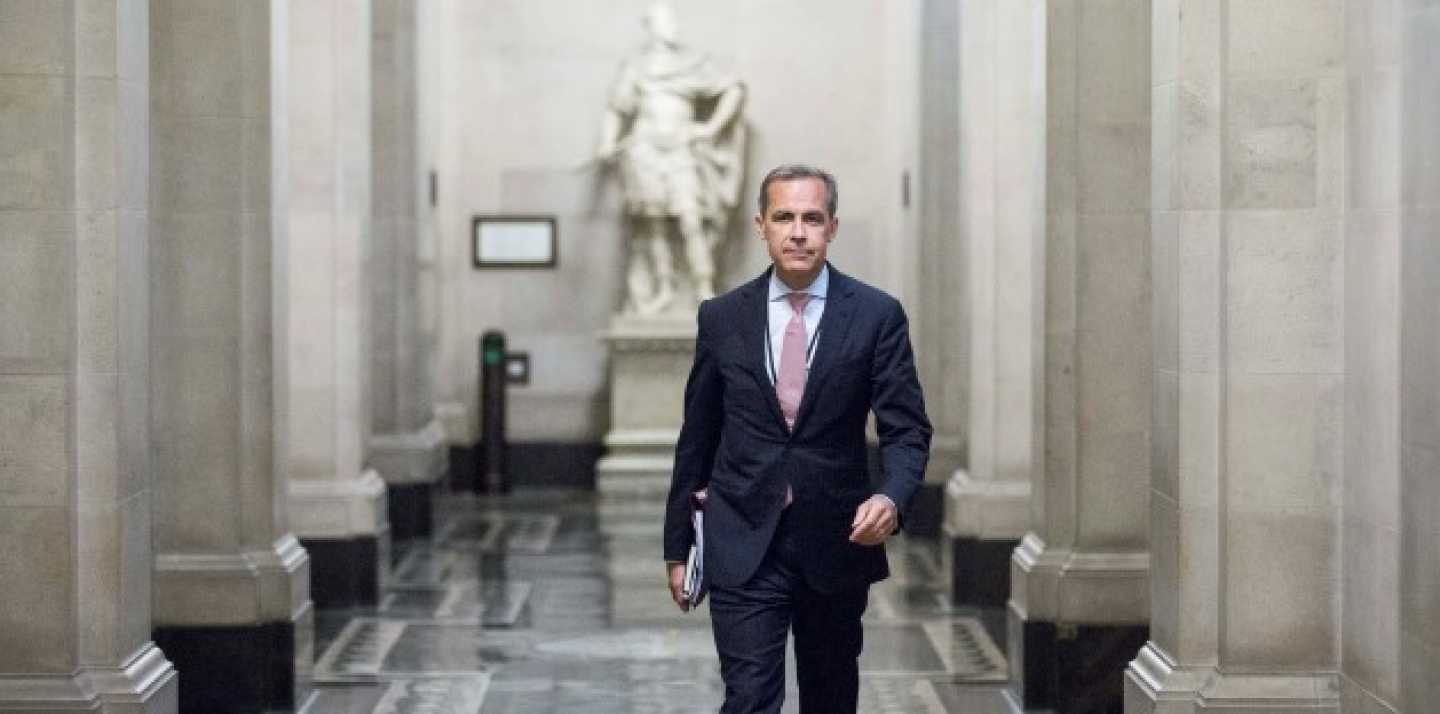 Mark Carney, the new Governor of the Bank of England, walks to a monetary policy committee (MPC) briefing. (AP Photo/Jason Alden/Pool)