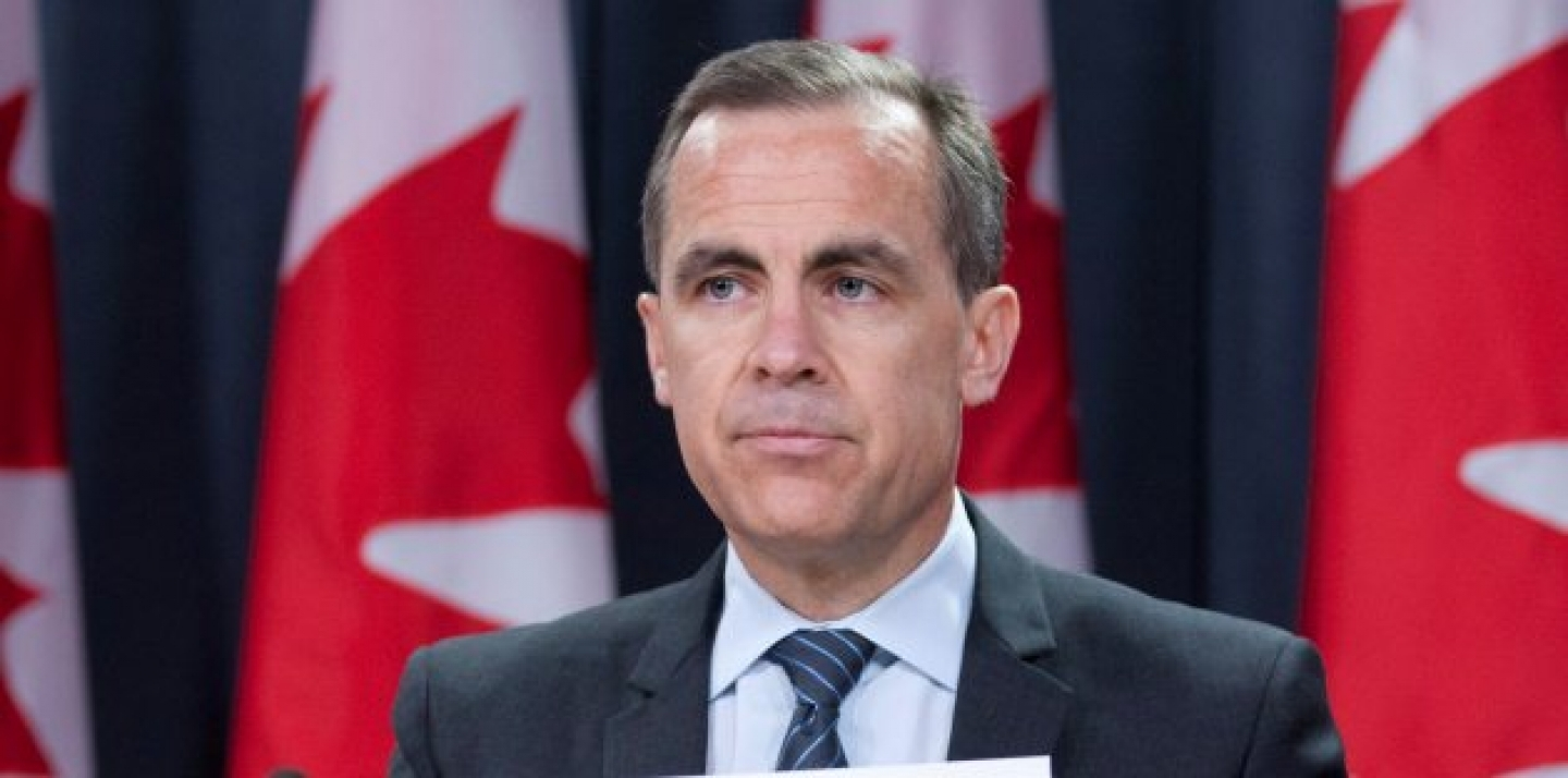 Bank of Canada Governor Mark Carney speaks with reporters during a news conference in Ottawa (AP Photo/The Canadian Press, Adrian Wyld).