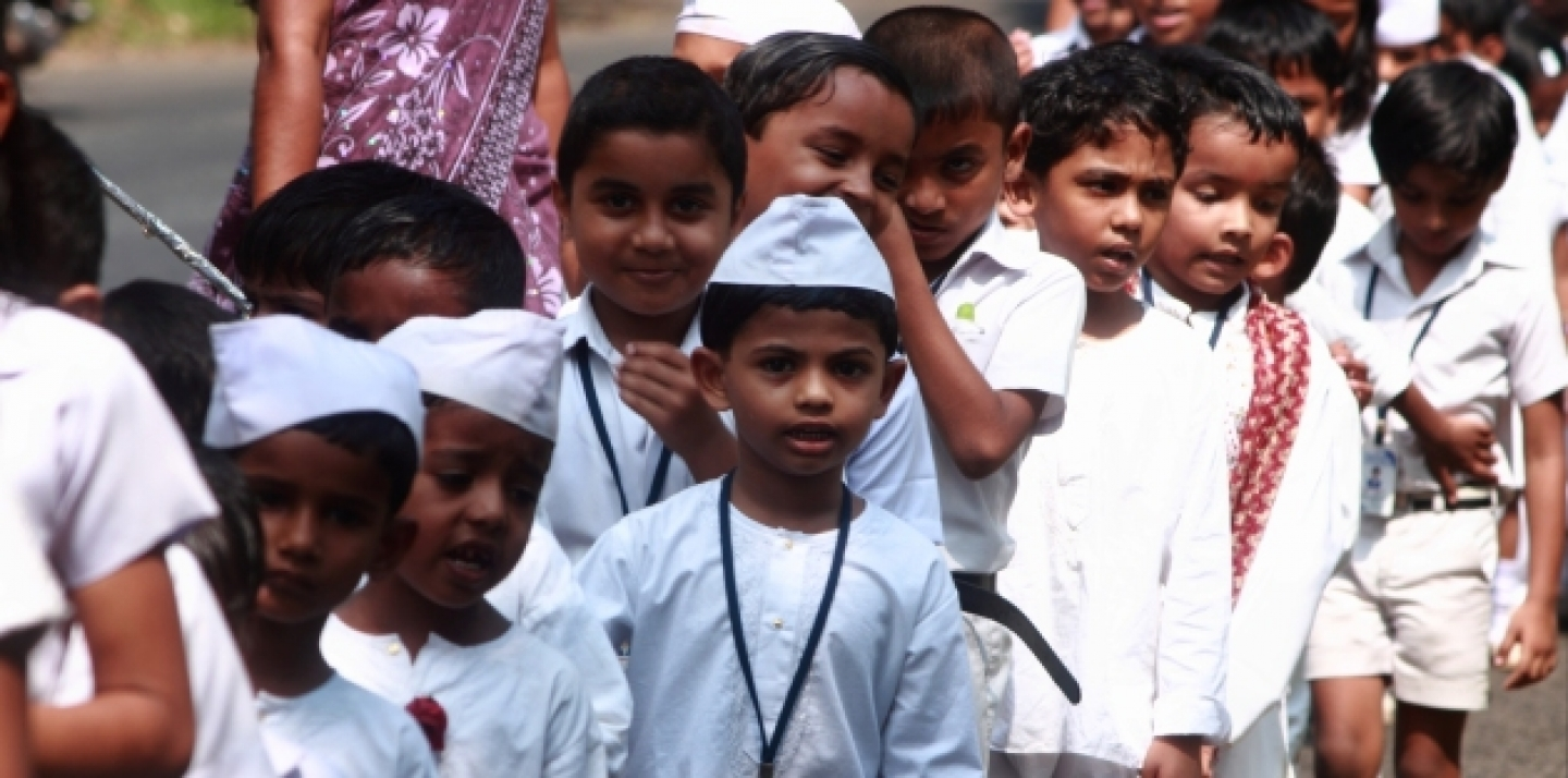 School children move in a line in Alleppey, India (AJP / Shutterstock).