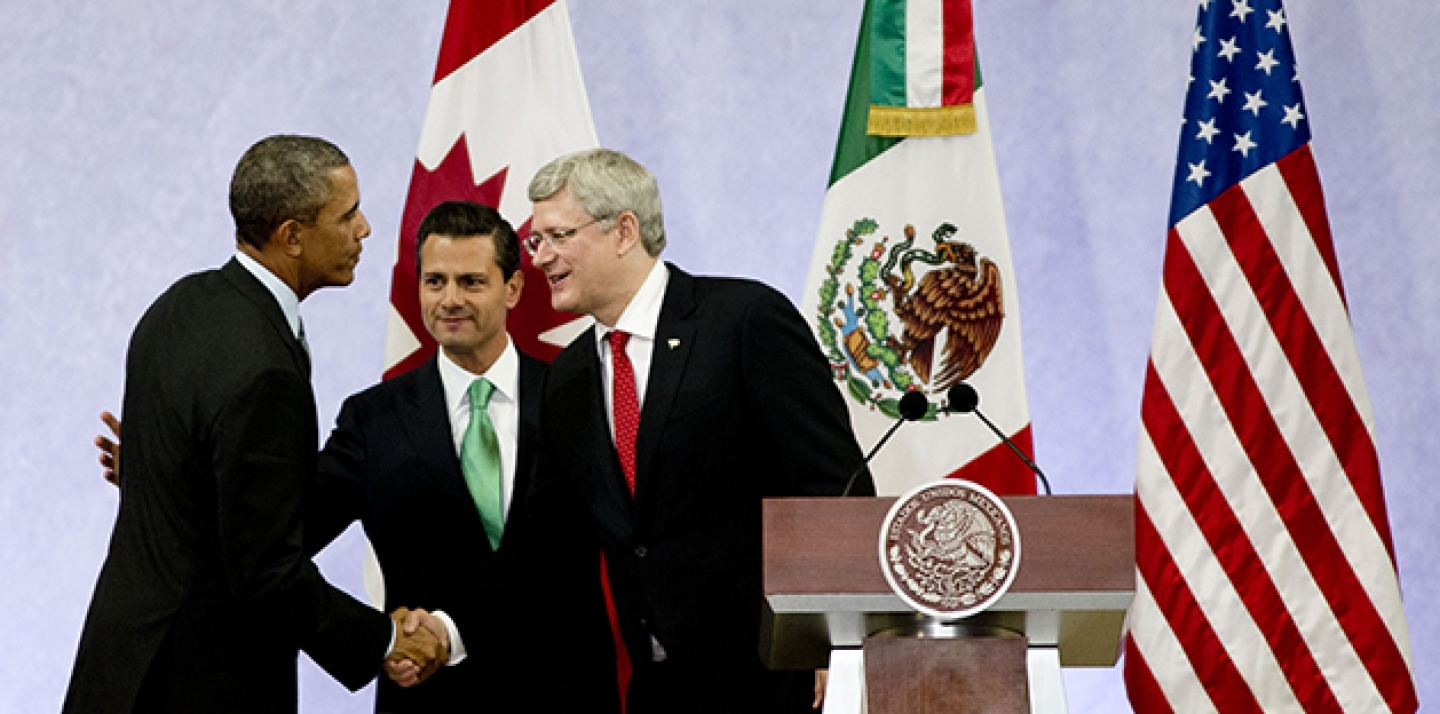 Barack Obama, Enrique Pena Nieto, and Stephen Harper met in  Feb. 19, 2014 to highlight the economic cooperation that has grown since NAFTA joined the U.S., Canada and Mexico 20 years ago. (AP Photo/Eduardo Verdugo)
