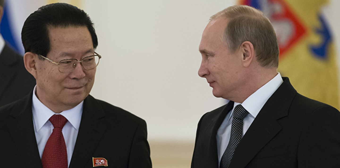 North Korea Republic Ambassador Kim Hyun-joon, and Russian President Vladimir Putin pose for a photo after presenting his credentials in the Kremlin in Moscow, Russia, Wednesday, Nov. 19, 2014. (AP Photo/Alexander Zemlianichenko, pool)