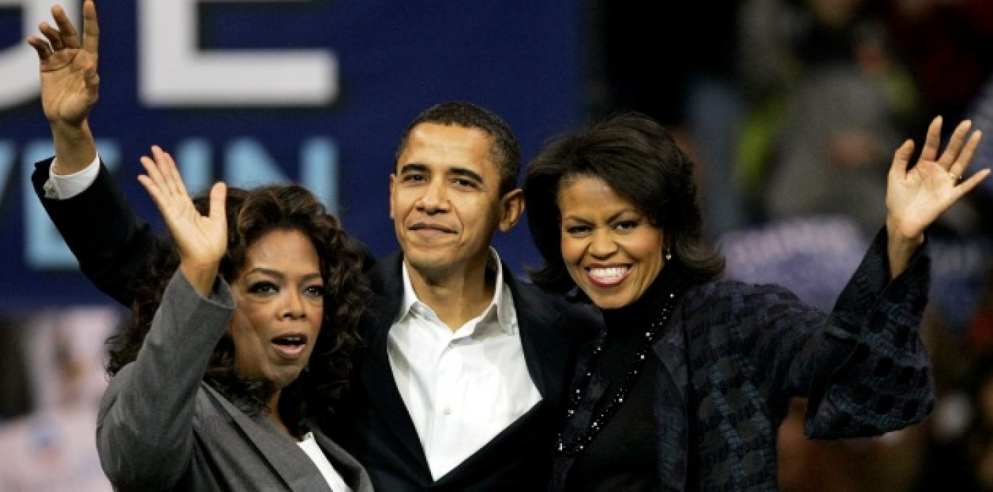 Barack Obama, his wife Michelle, right, and Oprah Winfrey wave to the crowd at a 2007 rally in Manchester, N.H. (AP Photo/Elise Amendola)