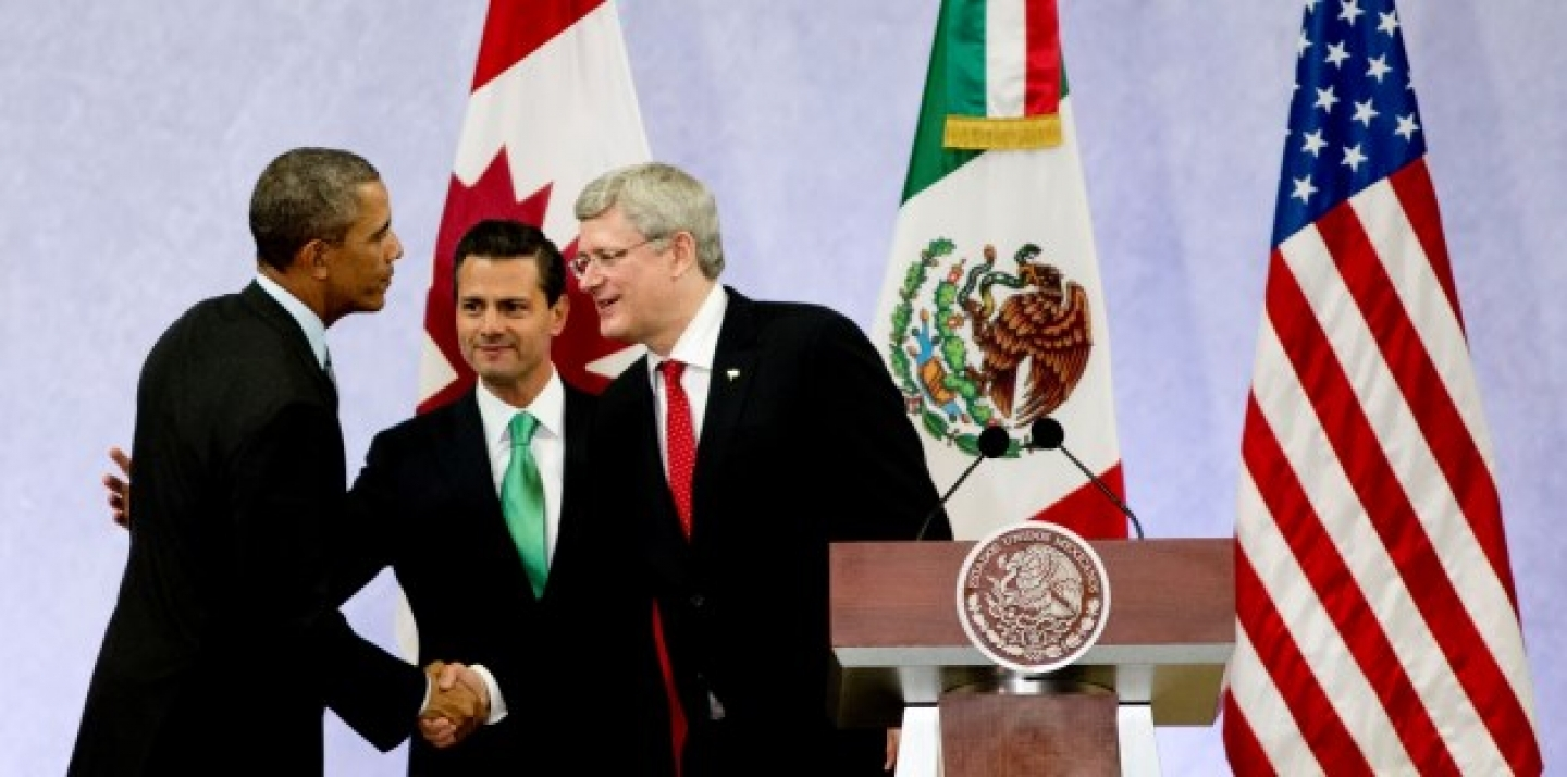 President Barack Obama, left, Mexico's President Enrique Pena Nieto, center, and the Prime Minister of Canada, Stephen Harper, shake hands at the North American Leaders Summit. (AP Photo/Eduardo Verdugo)