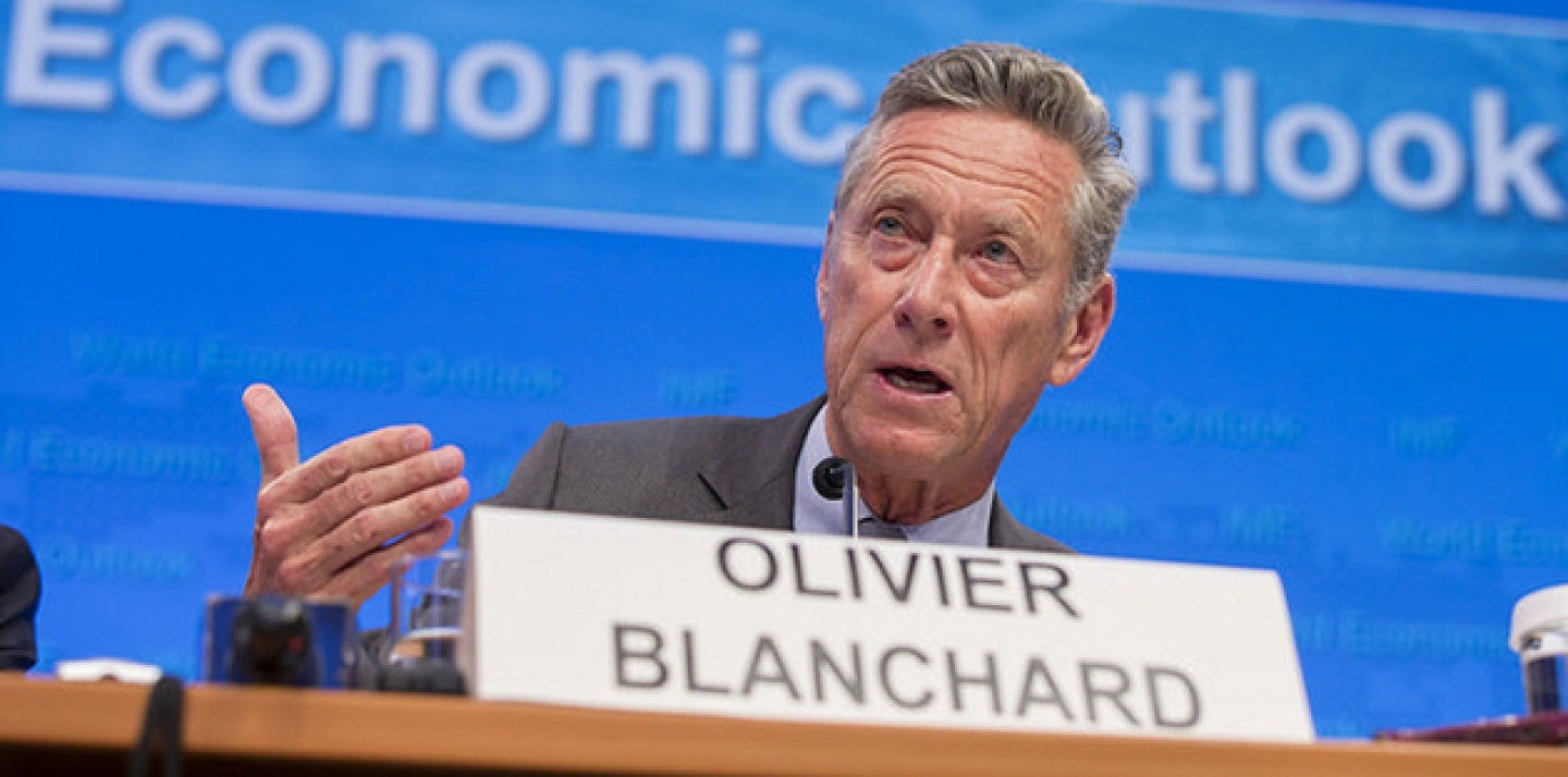 Olivier Blanchard speaks on a panel to discuss World Economic Outlook. (IMF Staff Photograph/Stephen Jaffe)