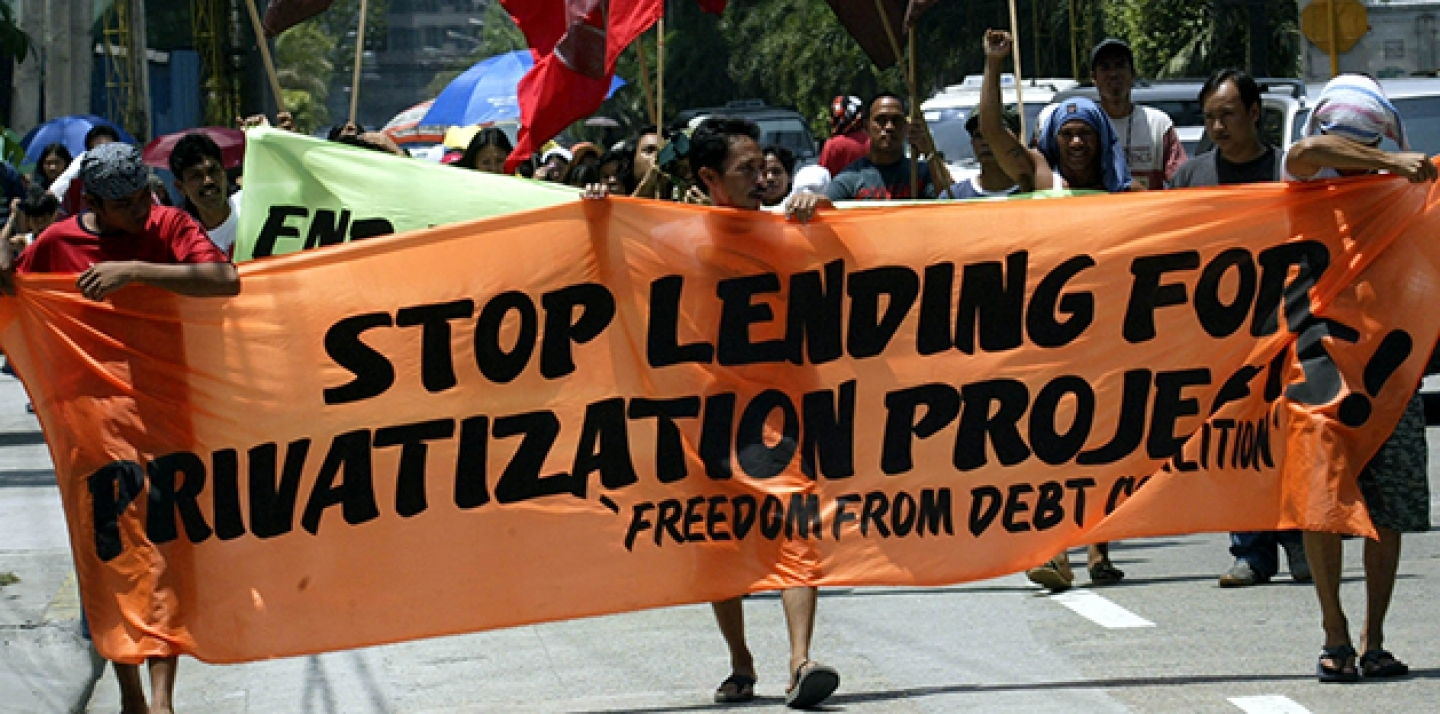 Protesters in the Philippines march towards the Asian Development Bank to demonstrate concerns over deepening poverty in the region caused by privitization programs of basic services such as power and water projects. (AP Photo/Pat Roque)