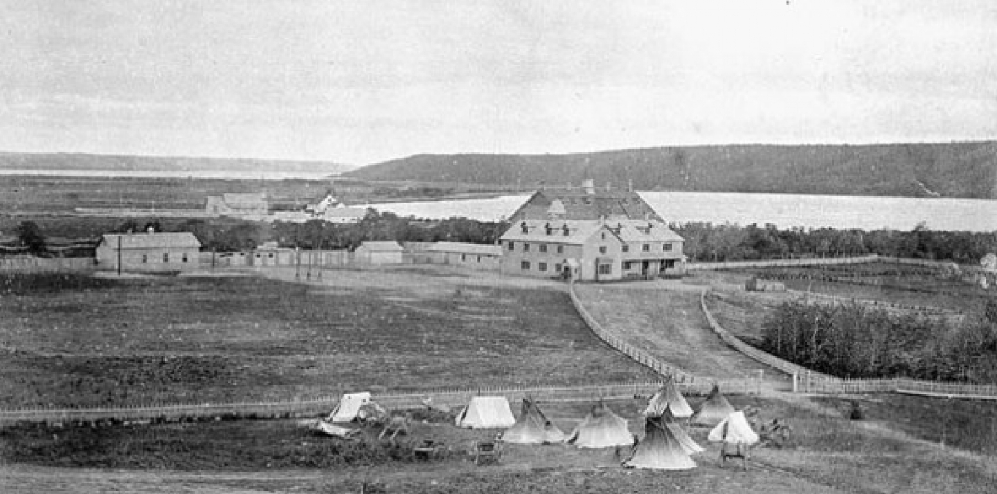 Qu'Appelle Indian Industrial School, Saskatchewan ca. 1885. Parents of Aboriginal children had to camp outside the gates of the residential schools in order to visit their children. This photograph appeared in the 1895 annual report of the Department of Indian Affairs. This image is available from Library and Archives Canada.