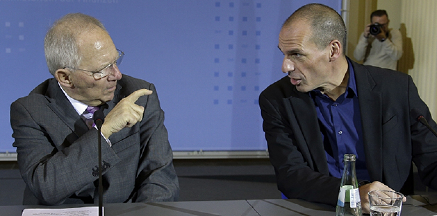 German Finance Minister Wolfgang Schäuble, left, pointing a finger to the Finance Minister of Greece, Yanis Varoufakis, right, during a joint press conference as part of a meeting in Berlin, Germany. (AP Photo/Michael Sohn, file)