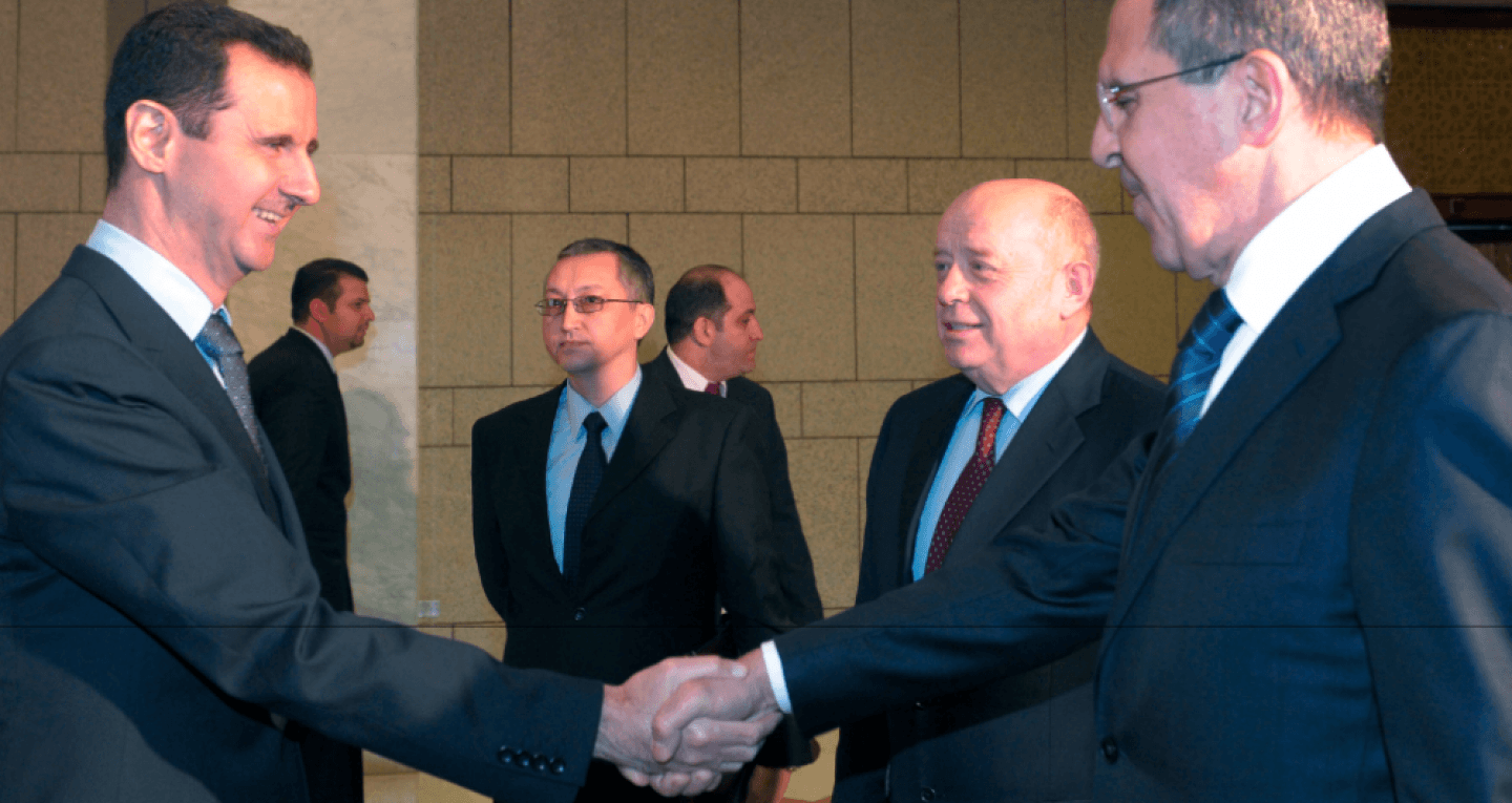 Syrian President Bashar Assad, left, shakes hands with Russian Foreign Minister Sergey Lavrov, right, as Russian Foreign Intelligence chief Mikhail Fradkov smiles second right, in Damascus, Syria on Tuesday, Feb. 7, 2012. (AP/STR)