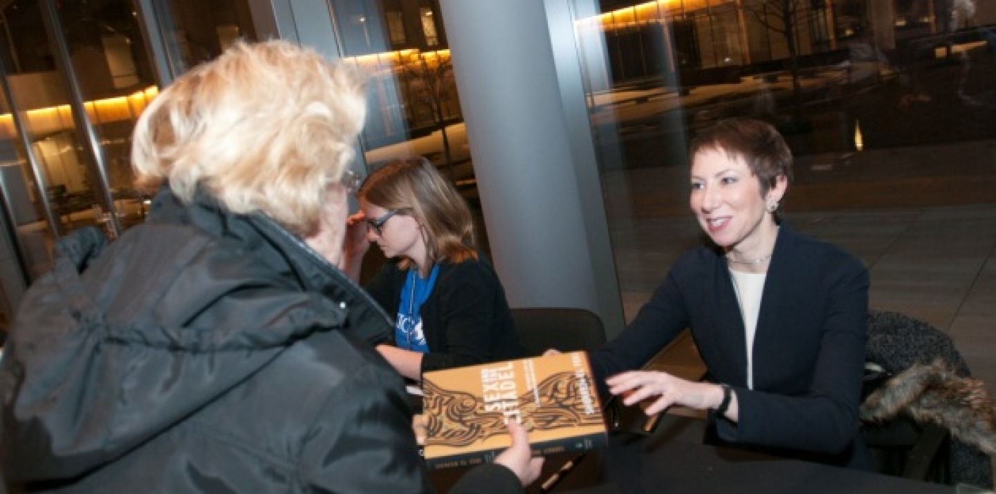 Author Shereen El Feki signs a book for an audience member, following her CIGI Signature Lecture (Lisa Malleck/CIGI).
