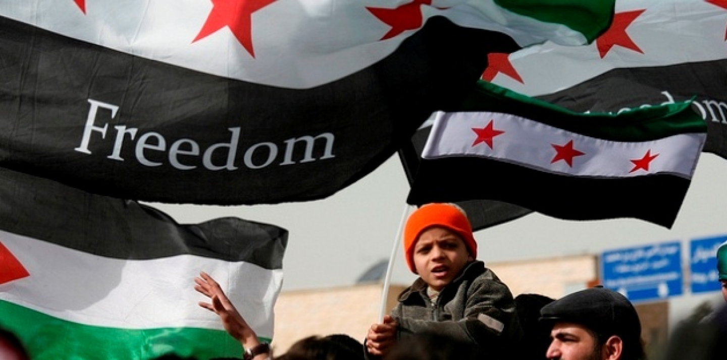 Syrians chant anti-Bashar al-Assad slogans during a protest in front of the Syrian embassy in Amman, Jordan (AP photo/Mohammad Hannon)