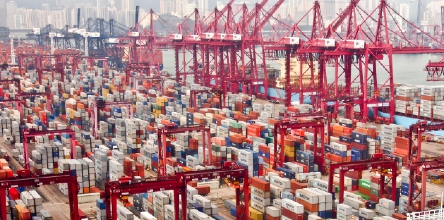 Containers at Hong Kong commercial port on Nov 24, 2012 in Hong Kong, China (Shutterstock)