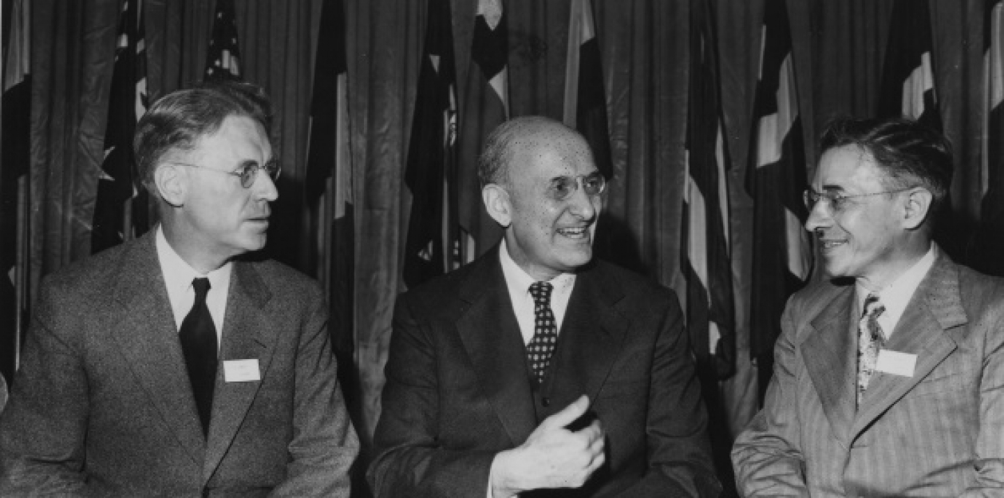 J.L. Ilsley, Canadian finance minister, U.S. secretary of treasury, Henry Morgenthau Jr., president of the conference and M.S. Stepanov, deputy people's commissar of foreign trade of the Soviet Union, from left to right, are pictured conversing during the United Nations Monetary and Financial Conference July 2, 1944. (AP Photo)