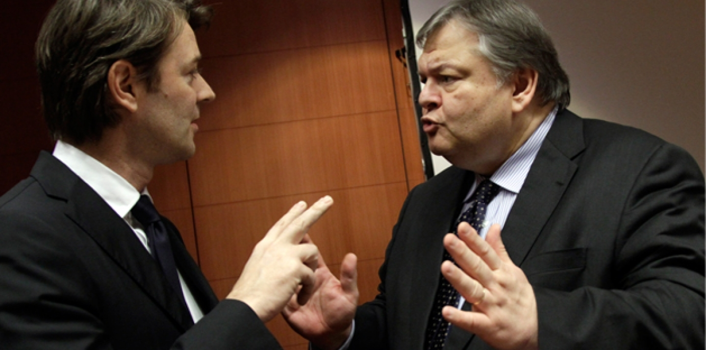 Greek Finance Minister Evangelos Venizelos, right, speaks with French Finance Minister Francois Baroin during a meeting of EU finance ministers in Brussels on Jan. 23, 2012 (AP Photo/Virginia Mayo).