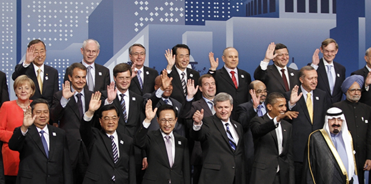 World leaders wave during a group photo at the G20 Summit in Toronto, 2010. (Lefteris Pitarakis, AP Images)