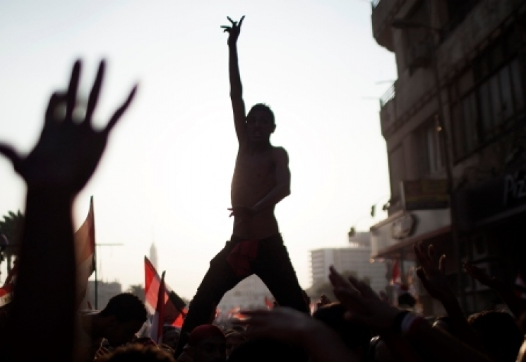 Egyptian protesters chant slogans against Egyptian Islamist President Mohammed Morsi, who was ousted later that day, in Tahrir Square in Cairo. (AP Photo/ Manu Brabo, File)