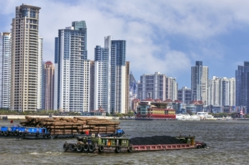 Shanghai - Coal and Timber Barges on the River Huangpu. (Shutterstock)