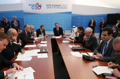British Prime Minister David Cameron, center, chairs a meeting on the humanitarian situation in Syria on the sidelines of the G-20 summit in St. Petersburg, Russia on Friday, Sept. 6, 2013. (AP Photo/Sergei Karpukhin, Pool)