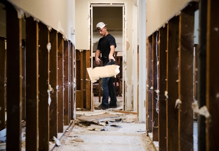 AP Photo/Matt Rourke - Clayton Mosley strips flood-damaged walls in the aftermath of Hurricane Harvey on Wednesday, Sept. 6, 2017, in Houston.