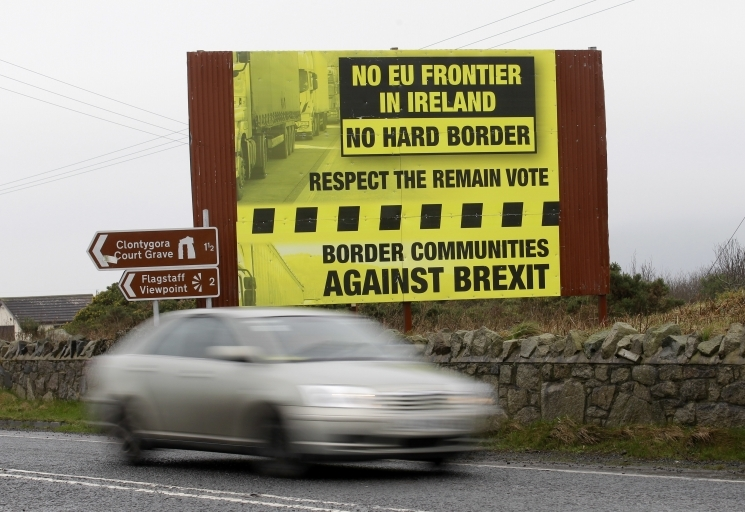 Brexit Irish border protest sign | AP Images | Peter Morrison
