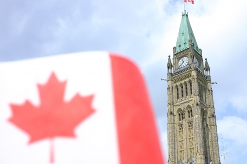 Canada national flag and parliament (Shutterstock)