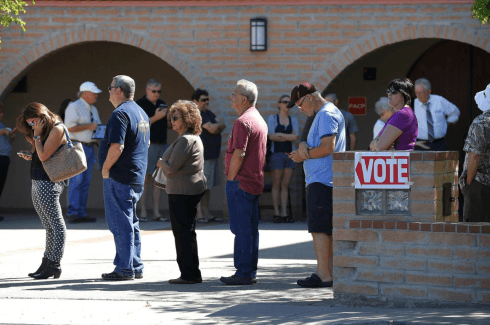 Constituents lining up to vote at a polling station