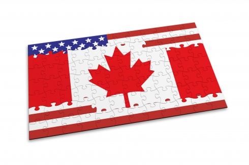 Canadian and US flags superimposed on one another