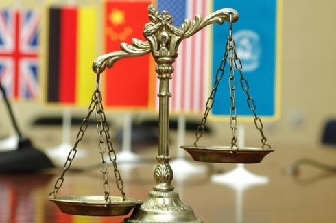 (Shutterstock) Scales of Justice with National flag of several countries