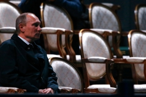 Russian President Vladimir Putin sits while waiting for other leaders arriving for the Water and Music Show during the G-20 summit at Peterhof Palace in St. Petersburg, Russia on early Friday, Sept. 6, 2013.(AP Photo/Alexander Zemlianichenko)
