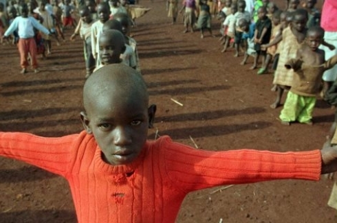 Rwandan refugee school children perform their morning exercise in the Benaco refugee camp near Ngara, Tanzania, Wednesday Nov 27 1996. (AP PHOTO/Jerome Delay)