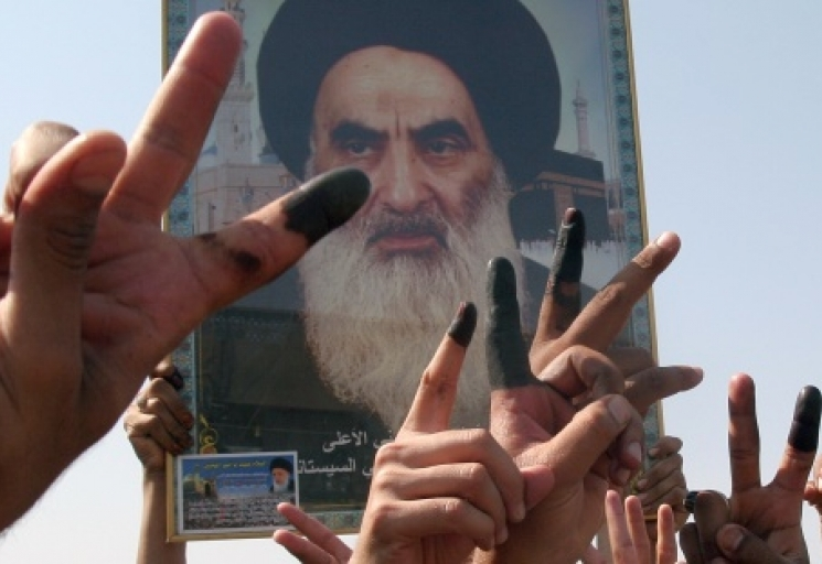 Iraqi Shiites flash victory signs, showing off their ink marked fingers, after voting in Iraq's constitution referendum, in Baghdad, Iraq, Saturday Oct. 15 2005. (AP Photo/Karim Kadim)