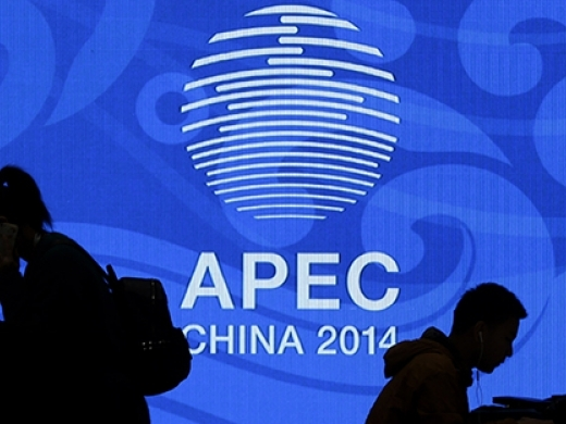 Journalists work at the media center for the Asia-Pacific Economic Cooperation (APEC) Economic Leaders' Week at the National Convention Center, one of the venue hold the summit, in Beijing, China Tuesday, Nov. 4, 2014. (AP Photo/Andy Wong)