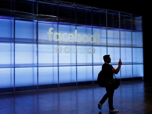 An attendee takes a photograph during Facebook Inc's F8 developers conference in San Jose, California on April 30, 2019. (Reuters/Stephen Lam)