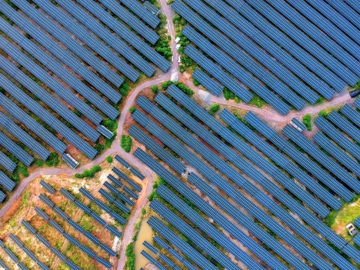 An aerial view of arrays of solar panels installed around the mountains and on the rooftops of buildings in Zhoutian town in China's Jiangxi province on June 16, 2019. (Reuters/Zhu haipeng)
