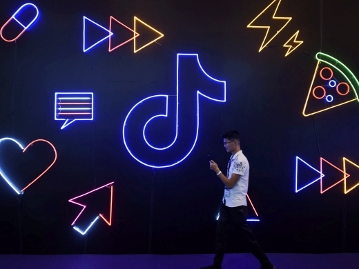 A man walks past a sign for ByteDance's app TikTok at an expo in Hangzhou. (REUTERS/Stringer)