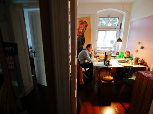 Holger Frohnmeyer studies with his son Rasmus while working from home during the spread of coronavirus disease (COVID-19) in Berlin, Germany, March 19, 2020. REUTERS/Fabrizio Bensch