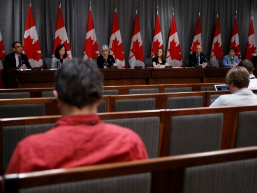 Government and public health officials attend a news conference as efforts continue to help slow the spread of coronavirus disease (COVID-19) in Ottawa, Ontario, Canada March 23, 2020. (REUTERS/Blair Gable)