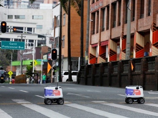 Delivery robots from the Colombian company Rappi, travel down a street amid the coronavirus disease (COVID-19) outbreak in Medellin, Colombia on April 17, 2020. (REUTERS/David Estrada)